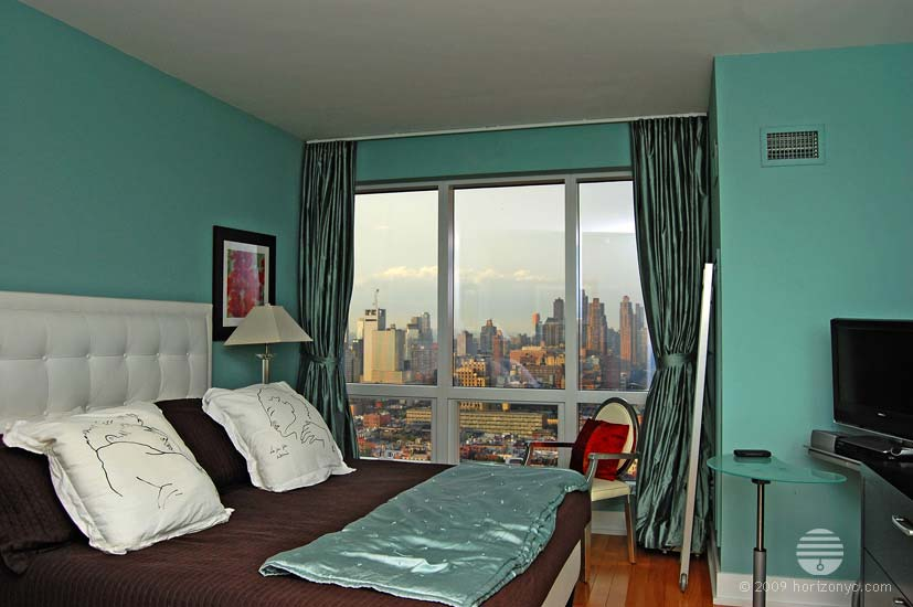 Turquoise silk tie back pinch pleated curtains The Orion 350 West 42nd Street NYC installed by Horizon Window Treatments