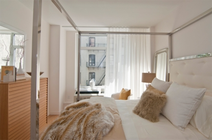 White sheer ripplefold curtains Bedroom floor to ceiling windows 306 West 116th Street NYC installed by Horizon Window Treatments